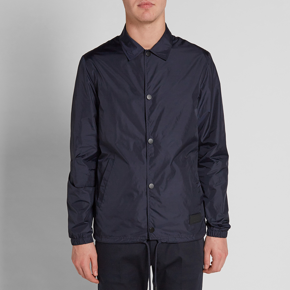 Acne studios tony face nylon coach jacket night blue for Coach jacket